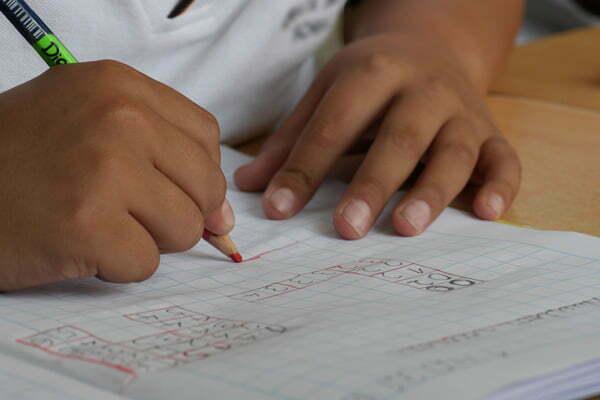 Child's hands doing math